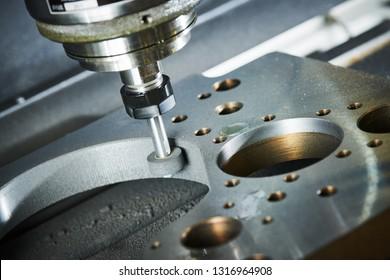 grinding or polishing metal detail on CNC machine.