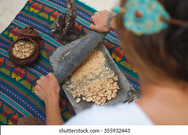 Grinding White Cacao