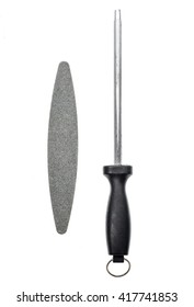 Grindstone or whetstone and sharpener on white background. Kitchen utensils