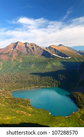 Grinnell Lake amidst the majestic mountain scenery of Glacier National Park in Montana