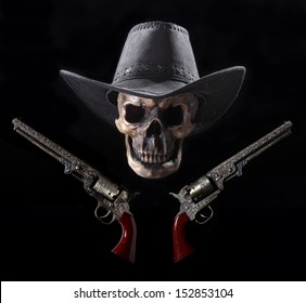 Grinning Cowboy Skull and Six-shooters