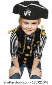 Grinning little girl wearing pirate costume, over white background