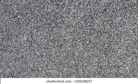 Grit stone background grey gravel (Pebble) floor texture, top view.