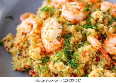 Grits cous cous with vegetables and grilled shrimp