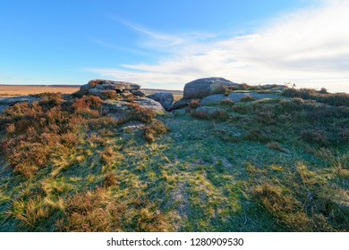 Gritstone rock formations in the Derbyshire Peak District on a clear frosty autumn morning