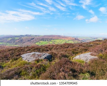 Gritstones and heather cover the Derbyshire landscape on a bright spring morning.