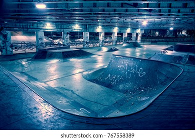 Gritty and scary city skate park at night in urban Chicago.