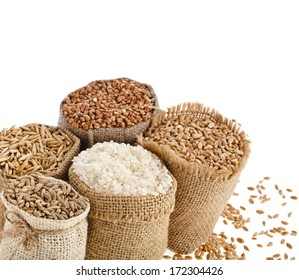 groats seed meal and grains in bags close up isolated on a white background