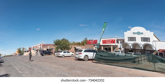 GROBLERSHOOP, SOUTH AFRICA - JUNE 11, 2017: A street scene with businesses and vehicles of Groblershoop, a town in the Northern Cape Province of South Africa