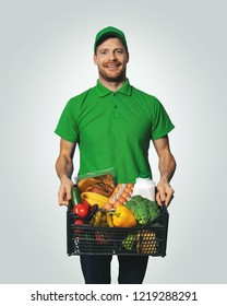 groceries delivery - man in green uniform with food box