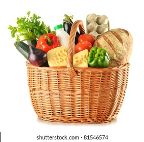 Groceries in large wicker basket isolated on white