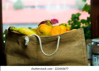 Grocery bag full of fruits.