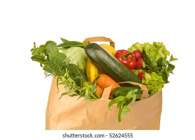 A grocery bag full of healthy vegetables