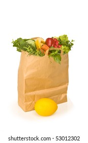 A grocery bag full of healthy vegetables - isolated on white