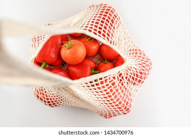 Grocery canvas tote string shopping bag with food. Vegetables in natural bag, eco friendly,flat lay.Sustainable lifestyle concept,zero waste food shopping. Plastic free, reuse, reduce, recycle, refuse