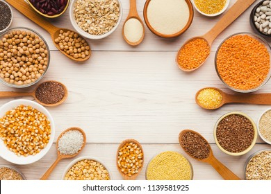 Grocery shop showcase. Cereals and legumes assortment on white wooden table, top view, copy space