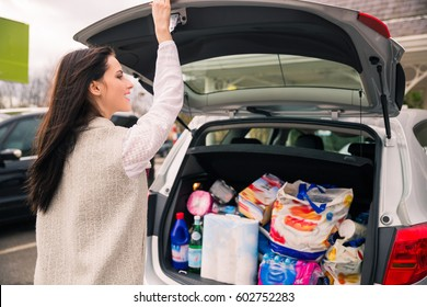 Grocery shopping done!  Woman  after shopping on parking lot with coffee