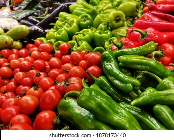 Grocery shopping. Grocer section. Tomato, pepper, cucumber, eggplant, zucchini.