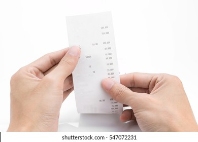 Grocery shopping list or receipt in hand - money account management concept