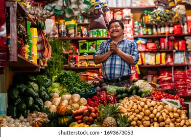 Grocery store in Guatemala and  a happy man with his hands in a praying position.