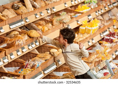 Grocery store - Little boy buying bread in a supermarket