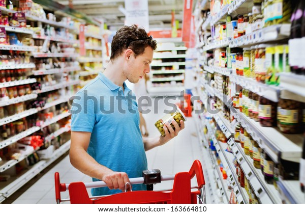 grocery store shopping, person choosing food in supermarket