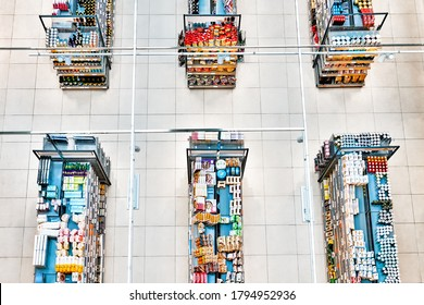 grocery store supermarket interior. Top down view of market shelves with variety of food goods. Inside of local shop. Various products and drinks view from above in mall in Moscow Russia on July 2020