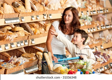 Grocery store - Woman with child in a supermarket choosing bread