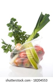 grocery-bag with vegetables and fruits isolated on a white background with a soft reflection