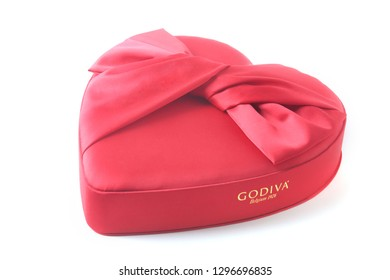 Grodno, 2018.12.10. Godiva. Red box in the shape of a heart for chocolate praline. Valentines day holiday concept background.