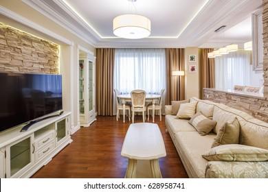 GRODNO, BELARUS - APRIL 26, 2017: luxure hall interior loft kitchen  guest room flat in beige pastel shades design