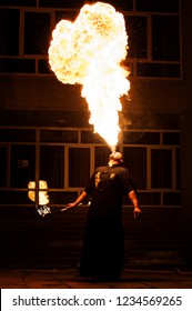 Grodno, Belarus - April, 30, 2012 fire show, fire blowing performance, dancing with flame, male master fakir with fire works on street arts festival, fire breathing trick