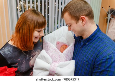 Grodno, Belarus - December 13, 2017: Happy father meets his wife with a newborn baby in perinatal center of Grodno city.