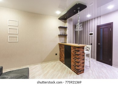 GRODNO, BELARUS - DECEMBER 15, 2017: Interior of the modern guest room hall  in loft flat in minimalistic style