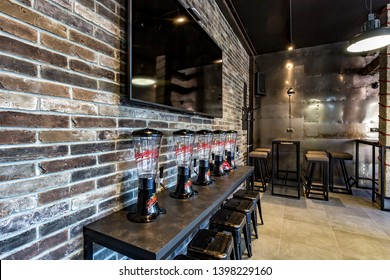 GRODNO, BELARUS - MARCH, 2019: inside interior in modern pub sport bar with dark loft design style with beer kegs