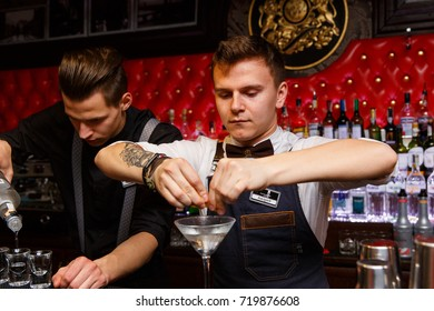 Grodno, Belarus - May 06, 2017: Two bartenders working in the London bar
