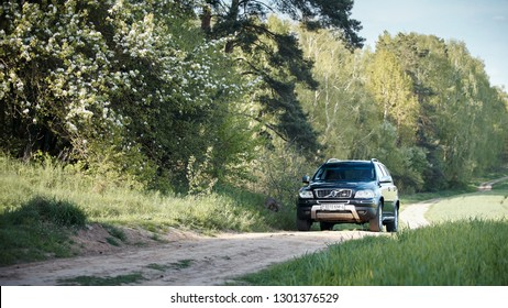 GRODNO, BELARUS - MAY 2015: Volvo XC90 4.4 v8 1st generation restyling 4WD SUV test drive in spring field country road on bloom and blossoms forest background in Grodno Belarus