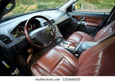 GRODNO, BELARUS - MAY 2015: Volvo XC90 4.4 v8 1st generation restyling 4WD SUV premium car interior brown leather with forest view from driver side