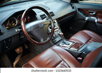 GRODNO, BELARUS - MAY 2015: Volvo XC90 4.4 v8 1st generation restyling 4WD SUV premium car interior brown leather with forest view closeup from driver side