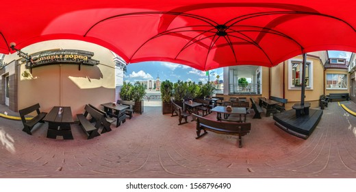 GRODNO, BELARUS - MAY 2019: Full spherical seamless hdri panorama 360 degrees in summer terrace in cafe of city center under an umbrella in equirectangular projection, VR AR content