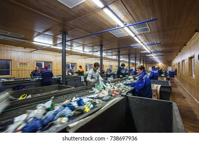 GRODNO, BELARUS - OCTOBER 16, 2017: Separate garbage collection. Recycling and storage of waste for further disposal. Workers trash sorting material to be processed in a modern waste recycling plant