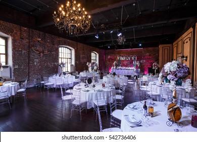 Grogeous restaurant hall prepared for wedding dinner