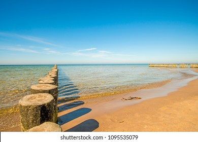 groins in the Baltic Sea with blue sky