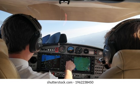 GRONIGEN, NETHERLANDS - 04 16 2021: Pilot student turning the heading buck while flying in simulated IMC with flight instructor monitoring