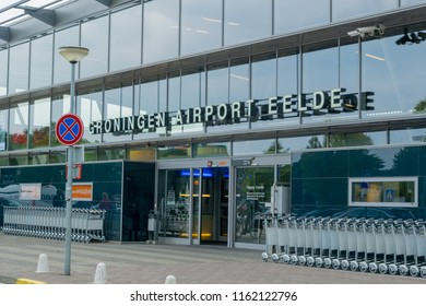 GRONINGEN AIRPORT EELDE, NETHERLANDS, AUGUST 15, 2018: The main entrance of Groningen Airport Eelde, departing and arriving travelers