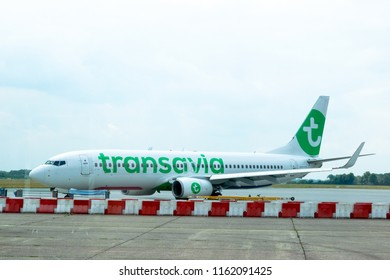 GRONINGEN EELDE AIRPORT, NETHERLANDS, AUGUST 15, 2018- A Transavia Boeing 737-800 parked at the gate in Groningen Eelde Airport, Netherlands