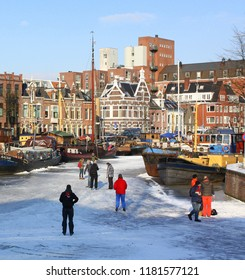 Groningen. February-10-2012. Skating in the harbour Noorderhaven and a background a historic buildings in the city of Groningen. The Netherlands