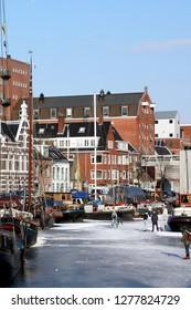 Groningen. February-10-2012. Skating in the harbour Noorderhaven in the city og Groningen. The Netherlands
