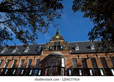 groningen, groningen/netherlands  - october 12, 2018:  facade and gable of the historic provincial government and administration building at martinikerhof