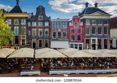 Groningen, Holland - 19 october 2018: terras sitting in Groningen at the cafe: de drie gezusters.